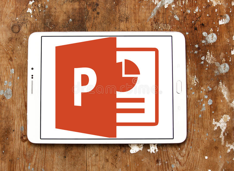 Microsoft powerpoint logo. Logo of microsoft office powerpoint program on samsung tablet on wooden background stock photography