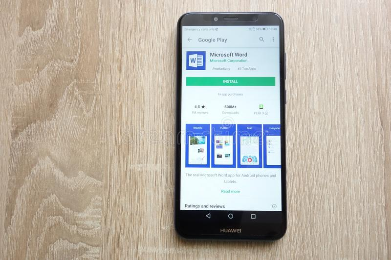Microsoft Word app on Google Play Store website displayed on Huawei Y6 2018 smartphone royalty free stock images