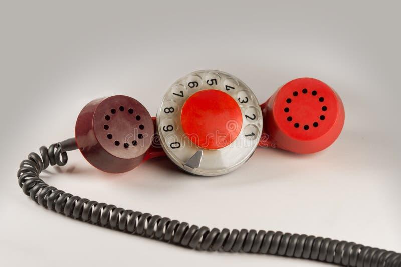 Microteléfono rojo viejo imagenes de archivo