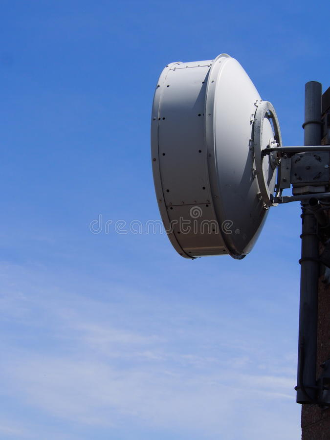 Microwave Antenna. Micro wave Antenna mounted on highrise building in the Bronx NY stock photography