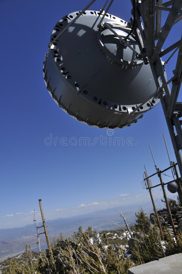 Microwave Antenna on Mtn.Peak. Remote Microwave Antenna on Top of Mountain Peak with Telecommunication Towers stock photography