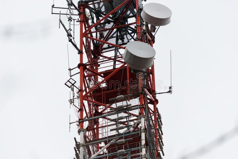 Microwave antenna tower. Lattice telecommunication tower with microwave and GSM antennas stock images