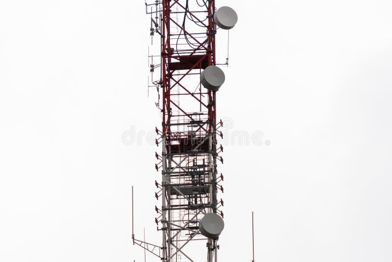 Microwave antennas. Lattice telecommunication tower with microwave and GSM antennas royalty free stock photos