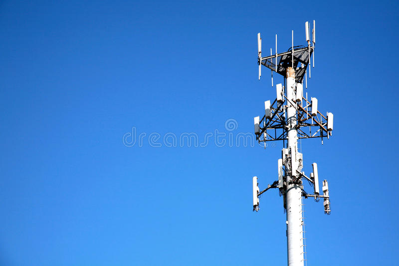 Microwave Communication Tower. Communication tower against a clear blue sky royalty free stock photos