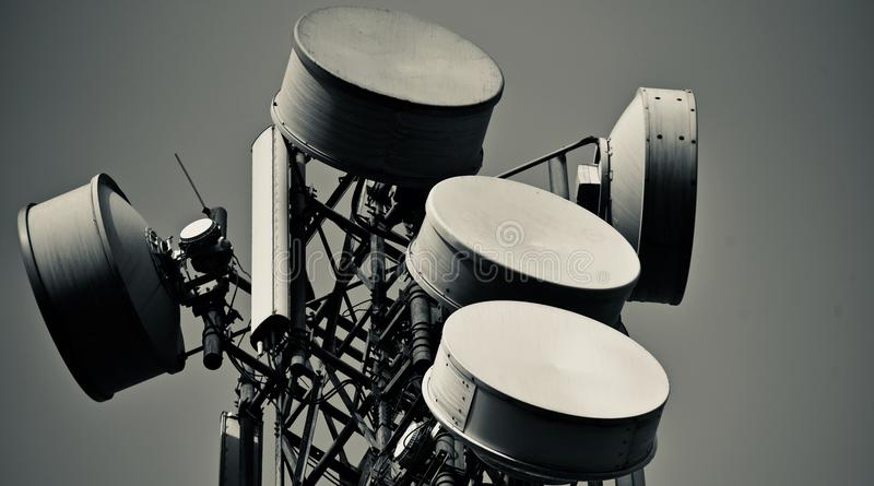 Microwave dishes isolated technology product photograph. Five microwave dishes of a large cellphone network tower isolated technology product stock photograph royalty free stock photo