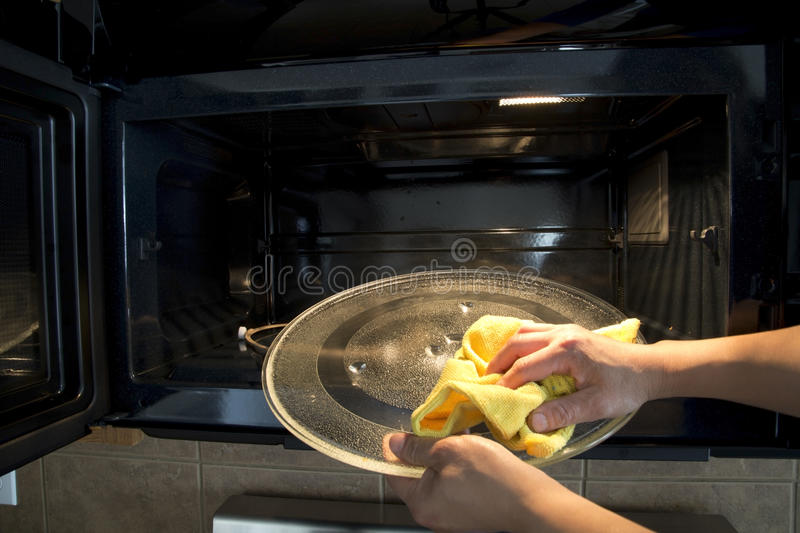 Microwave oven cleaning stock photos