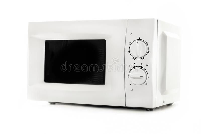 Microwave oven close up on white background.Kitchen equipment royalty free stock image