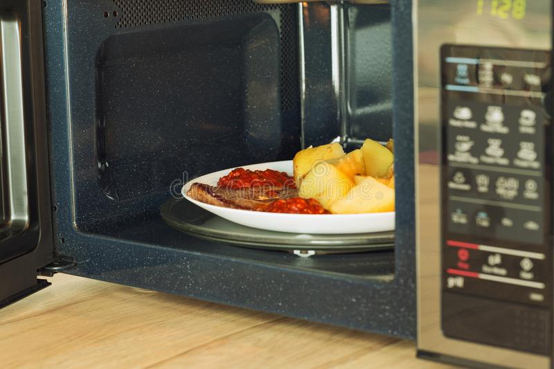Microwave oven with a heated meal stock photo