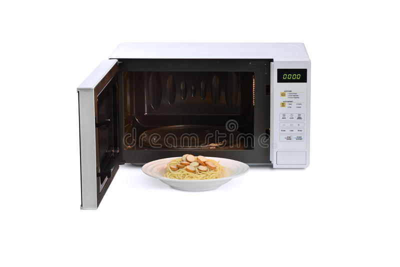 The microwave oven is warm fried noodles. royalty free stock photography