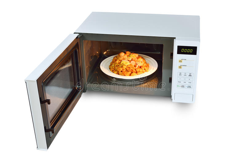 The microwave oven is warm stir Fried Macaroni on white background. stock photo