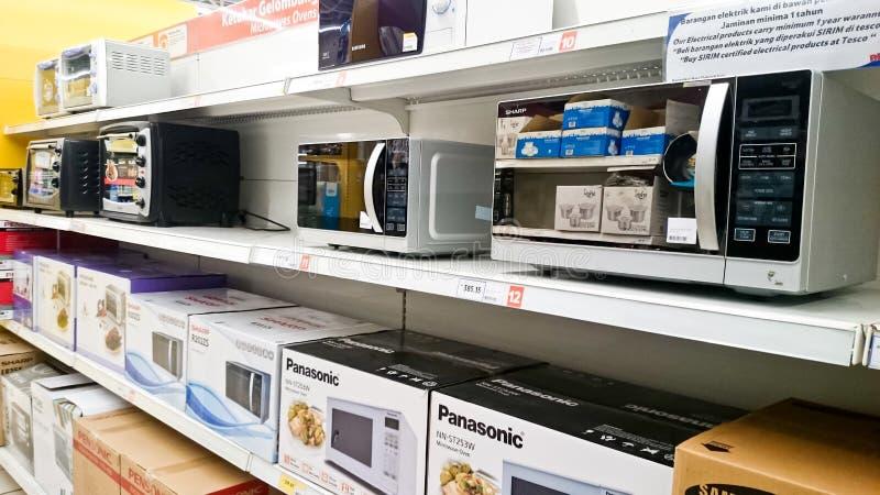 Microwave on shelf stock photo