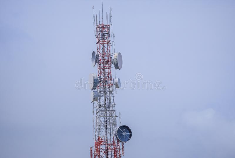 Microwave Transmitter at Telecommunications tower. Telecommunication tower with antennasr. Microwave Transmitter at Telecommunications tower. Wireless royalty free stock images