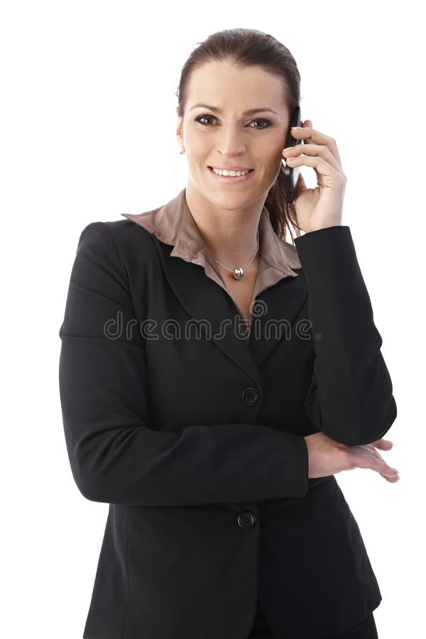 Mid Adult Businesswoman With Cellphone Stock Photos