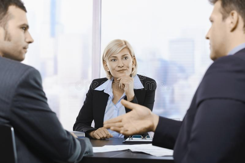 Businesswoman concentrating at meeting royalty free stock photo