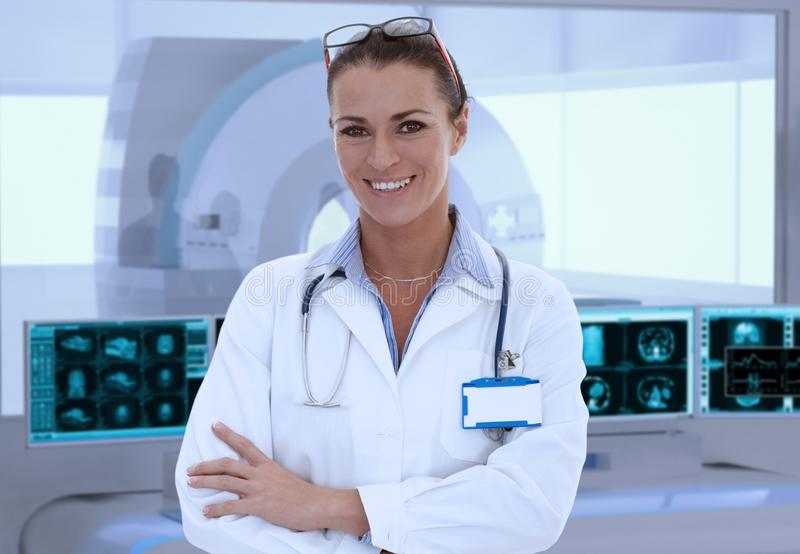 Mid-adult female doctor in MRI room at hospital stock images