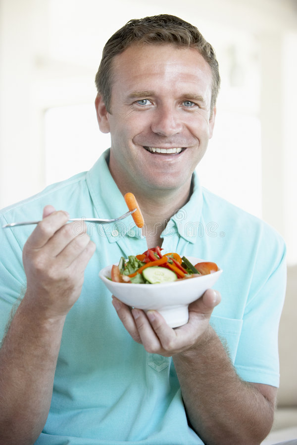 Mid Adult Man Eating A Salad royalty free stock photo