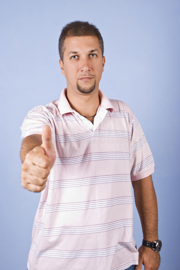Mid adult man giving thumbs up royalty free stock photo