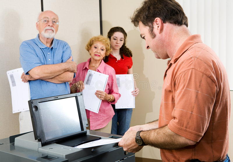 Mid Adult Man Voting Royalty Free Stock Photography