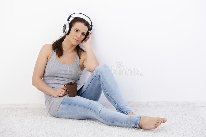 Download Mid-adult Woman Enjoying Music Stock Image - Image of dreamy, closed: 20444895
