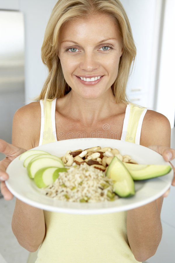 Mid Adult Woman Holding Plate With Healthy Foods stock photos