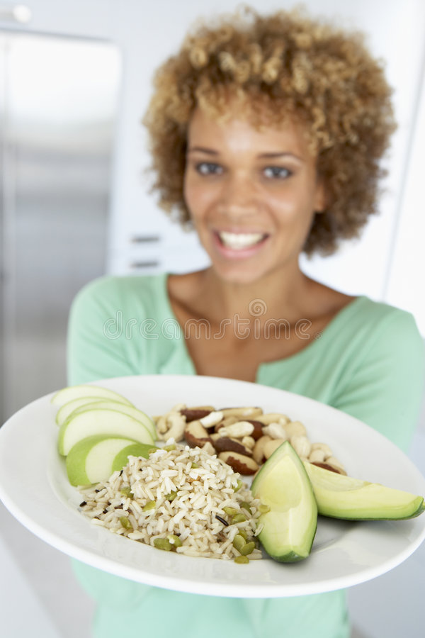 Mid Adult Woman Holding Plate With Healthy Foods.  royalty free stock images