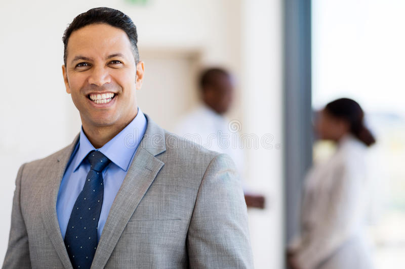 Mid age business leader. Good looking mid age business leader in office stock photo