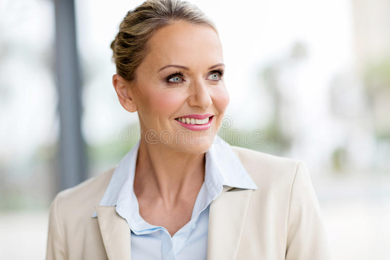 mid age businesswoman looking stock photo