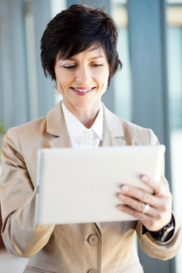 Download Mid Age Businesswoman Tablet Computer Stock Photos - Image: 26197153