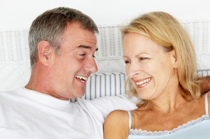 Mid age couple in bed stock photo