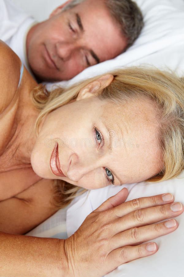 Download Mid Age Couple In Bed Royalty Free Stock Photo - Image: 21012545