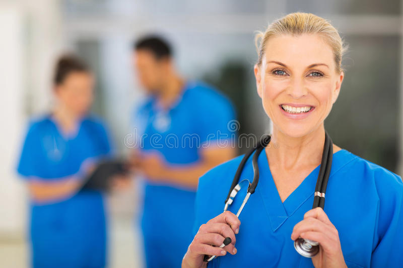 Mid age female nurse stock photography