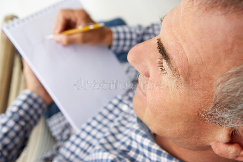 Mid Age Man Sketching Royalty Free Stock Photo