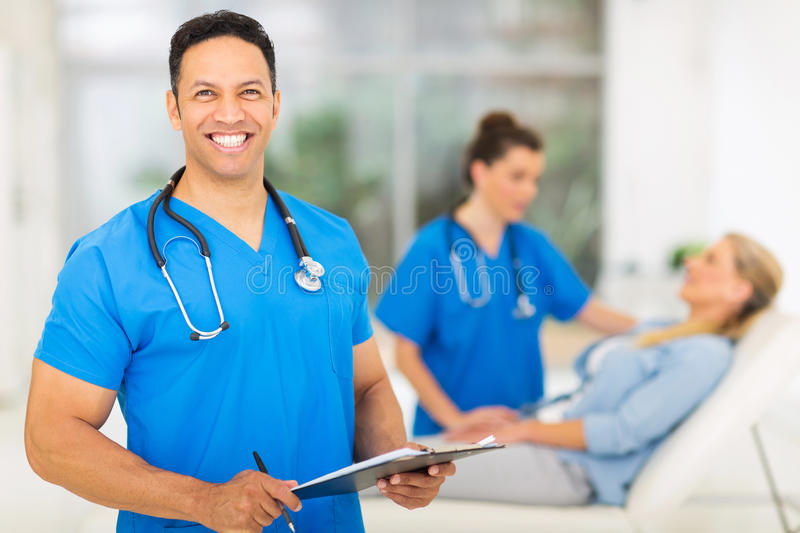 Mid age medical professional. Happy mid age medical professional in office royalty free stock images