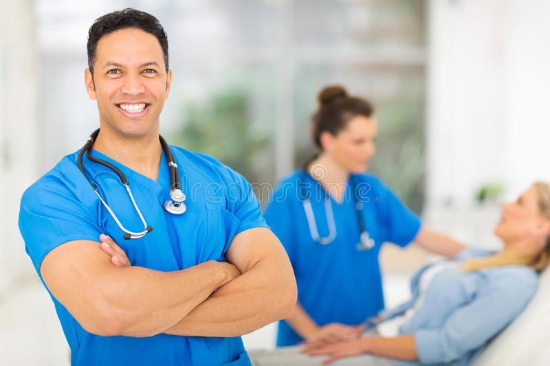 Mid age medical worker. Good looking mid age medical worker with arms folded royalty free stock photo