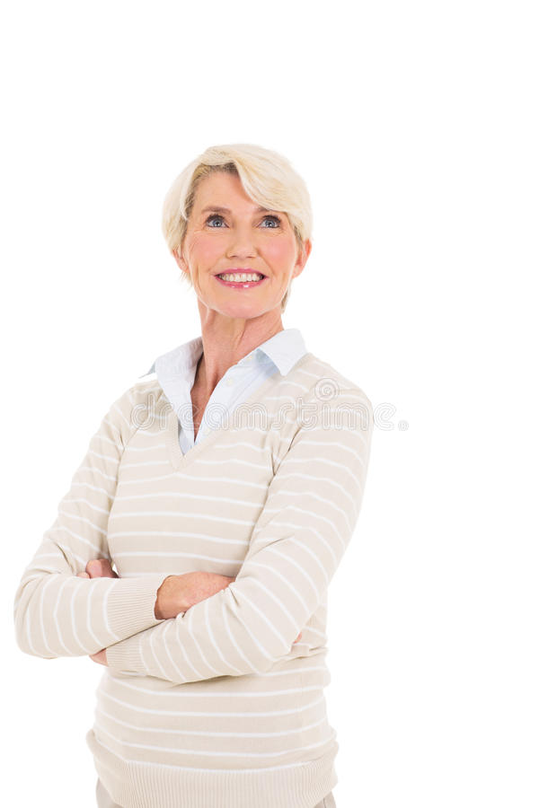 Mid age woman looking up. Gorgeous mid age woman looking up on white background royalty free stock images