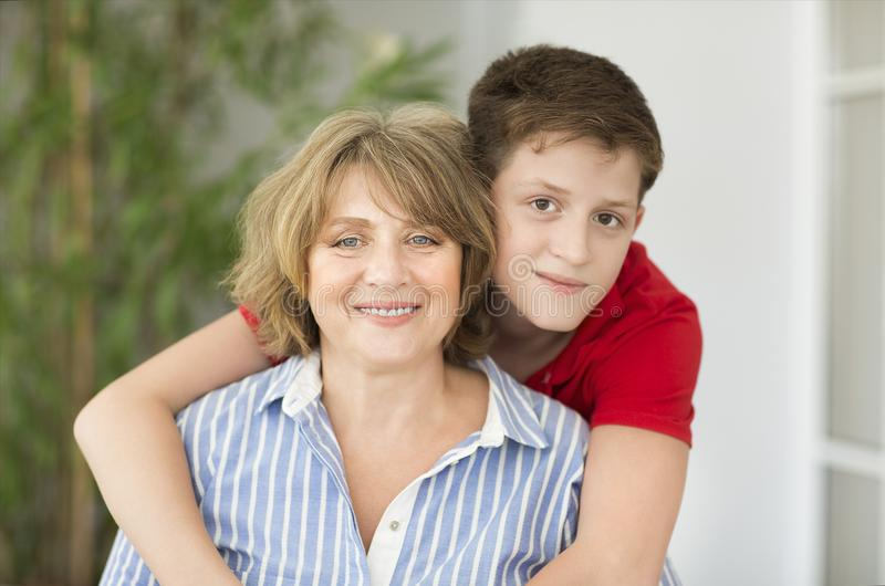 Mid-age woman with teen boy. Mid-age women with teen boy. Happy family concept stock images