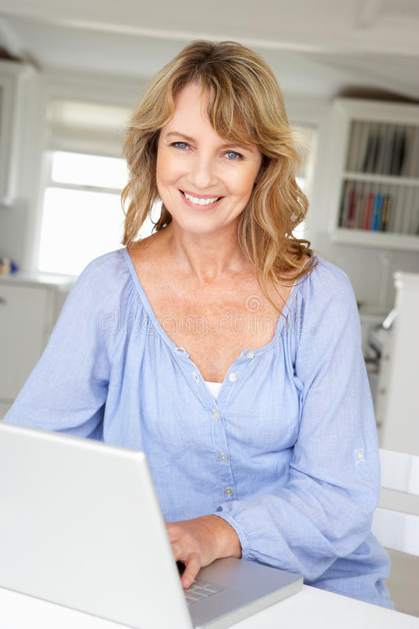 Download Mid age woman using laptop stock image. Image of businesswoman - 21044073