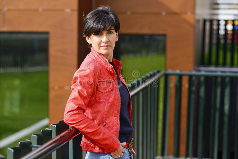 Mid aged woman wearing casual clothes outdoors stock image