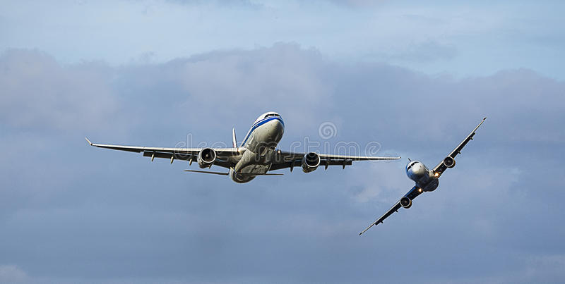 2 aircraft in Mid Air Collision / Near Miss. 2 passenger aircraft almost colliding in mid air stock photos
