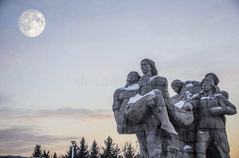 Mid Autumn Festival and Martyr statue. Mid Autumn Festival, Martyr statue under the full moon.At peony river, I arrived eight females of the Zhao hurl river royalty free stock photos