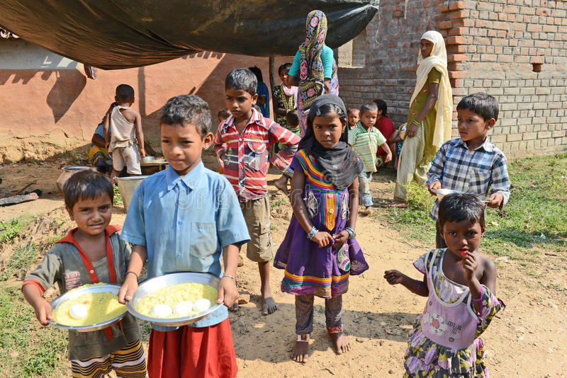 Mid-Day Meal. Students are gathering for mid-day meal in a rural school of West Bengal stock images