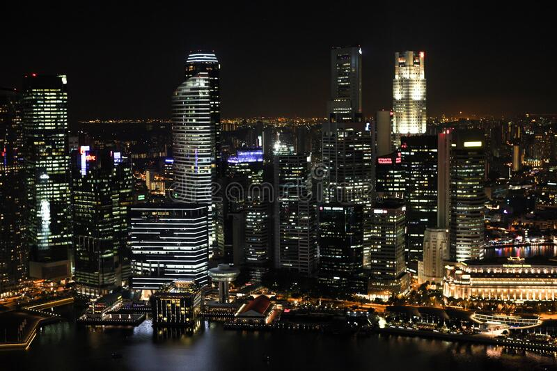 Mid and High Rise Buildings With Lights Turned on during Night royalty free stock photo