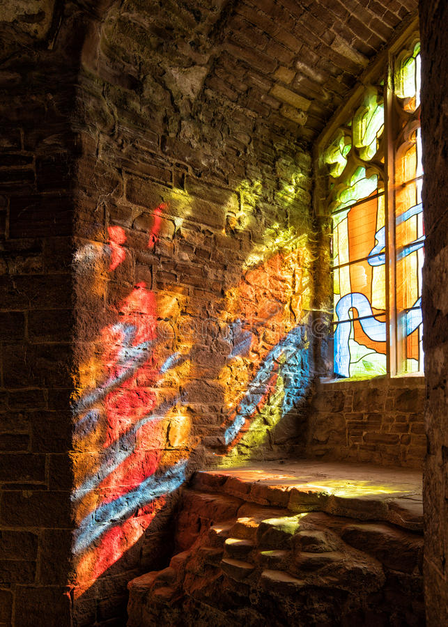Sunlight streaming through a stained glass window, Goodrich Castle, Herefordshire. royalty free stock photography