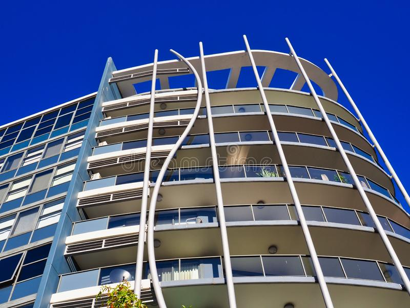 Mid Rise Modern Apartment Block. Multi level mid rise apartment or condominium block with balconies on curved facade, Perth, Western Australia, with clear deep royalty free stock photos