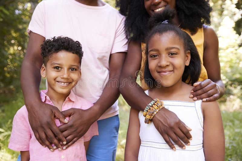 Mid section of black couple and their two children, portrait royalty free stock photos