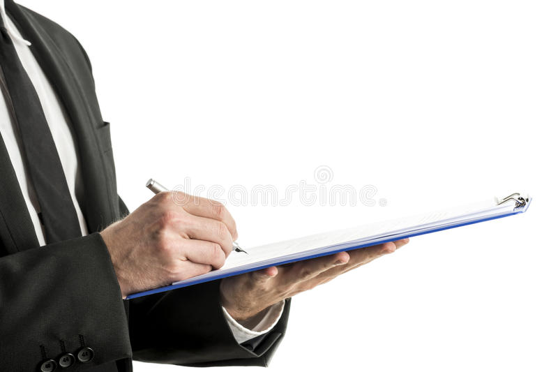 Mid section of business man writing on clipboard stock images