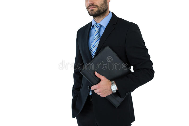 Mid section of businessman holding folder royalty free stock image