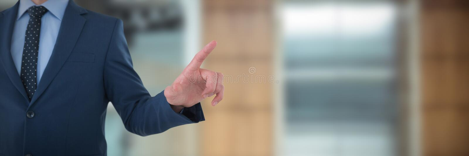 Mid section of businessman selecting on imaginary screen against lift in office building royalty free stock images