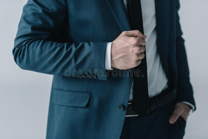 Mid section of businessman in stylish suit posing stock photography