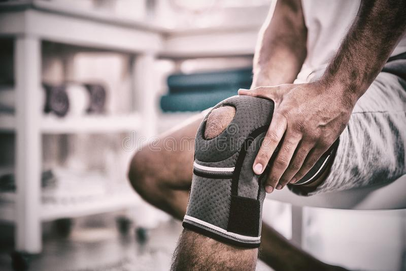 Mid section of man with knee injury. In clinic royalty free stock photography